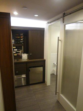 Hotel 48LEX New York: Restroom door, wine bar, cabinet (with plates/cups etc)