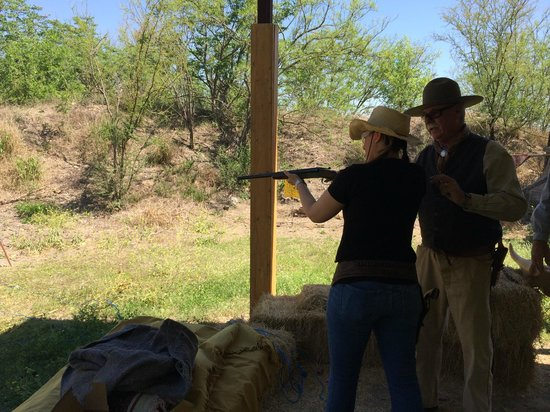San Antonio Western Shooting: My sister being instructed on how to properly shoot.