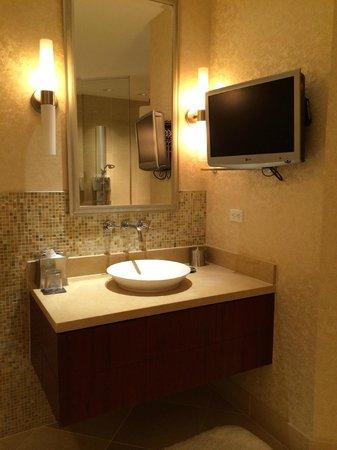 Bathroom Sinks Las Vegas presidential suite - bathroom sink area with tv - picture of