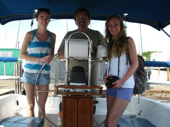 At the Helm Sailing Charters : Captain Mickey and the girls on our sailing adventure!
