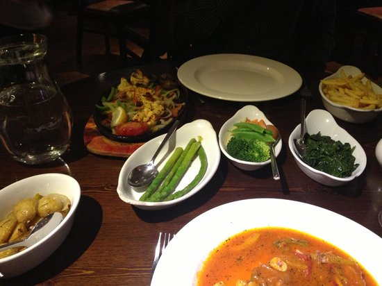 Figaro's: Chicken daviola spinach sauté potatoes asparagus chips and king prawns