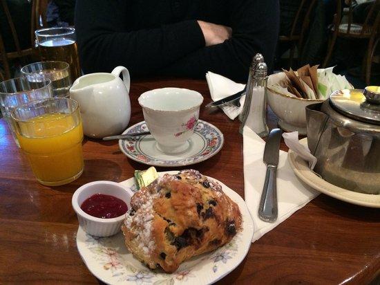 Queen of Tarts : The queens light start; scone (I chose blueberry) butter, raspberry preserve, tea and orange jui
