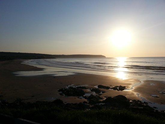 Gold Coast Golf Resort: Sunrise on Clonea Strand