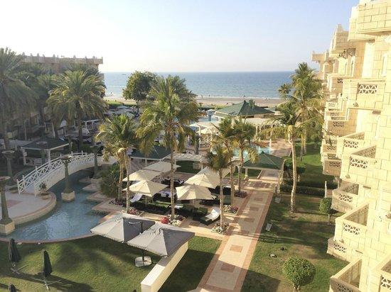 Grand Hyatt Muscat: Grand Hyatt balcony view looking at the lawn, pool and sea