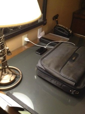Hyatt Regency Valencia: The only outlet for computer or cell phone. Only one could be plugged in. NO FREE WIFI!