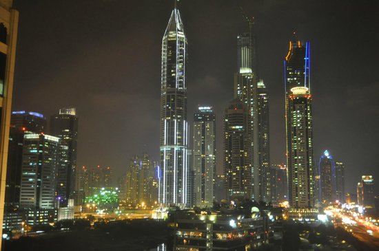 Arjaan by Rotana: Night time view from our balcony