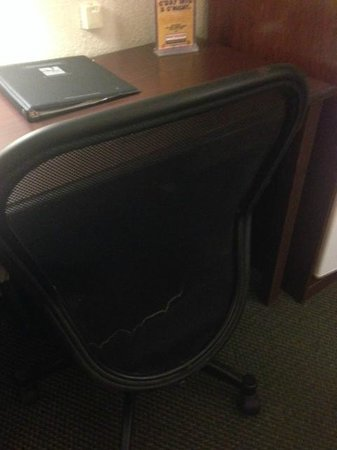 Quality Inn: Desk chair with some kind of stain on the back, may be unable to see