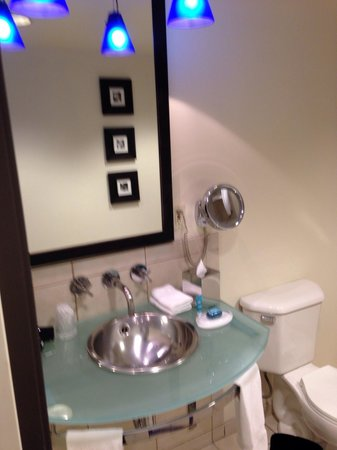 Aloft Silicon Valley: The beautiful sink, with the 'Bliss' soap and also lotion. The bathroom is very well decorated.