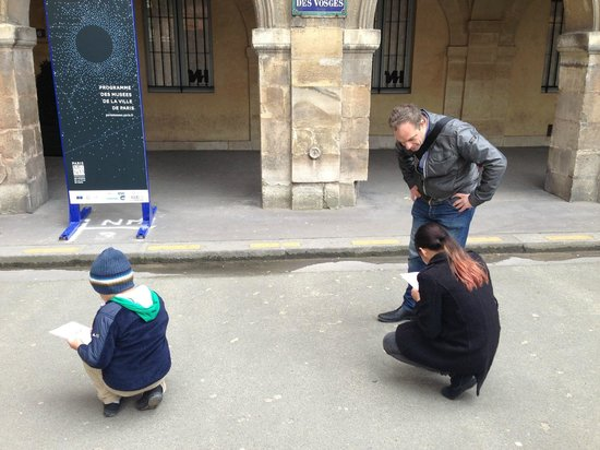 Paris Muse Private Tours: Patrick and my kids solving clues at the start of the tour.