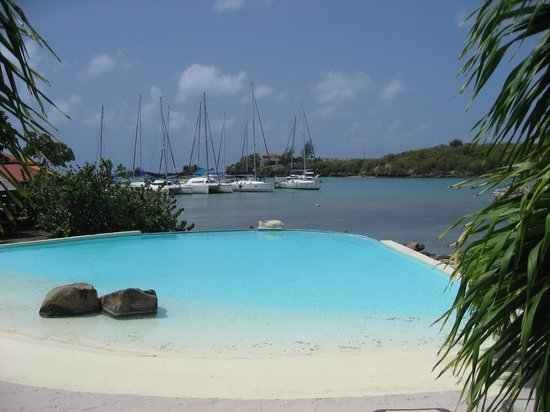 True Blue Bay Boutique Resort: View of Marina from Infinity Pool