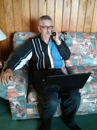 The Cedarwood Inn and Suites: My Dad sitting in the living room real-estating