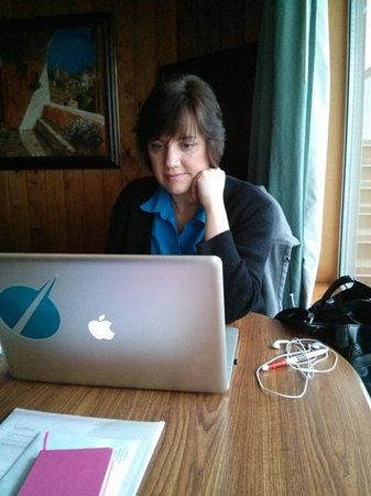 "The Cedarwood Inn and Suites: Sitting in the ""dining space"" working on the final edit of my novel"