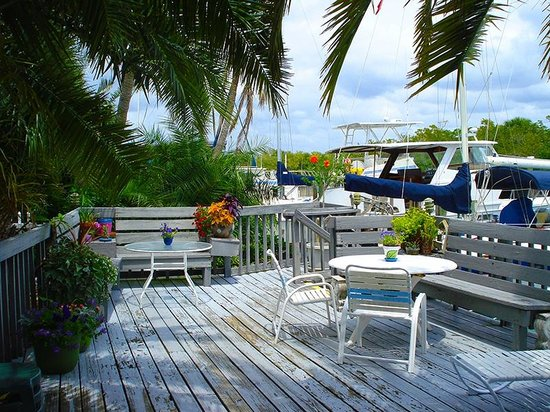 A Place to Be Motel: Deck that overlooks the waterway and heads to the docks. See the boats?