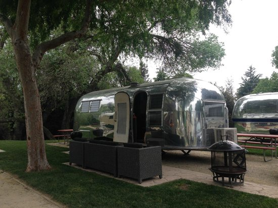 Flying Flags RV Resort & Campground : Updated Airstream without outdoor furniture and included fire pit and grill.