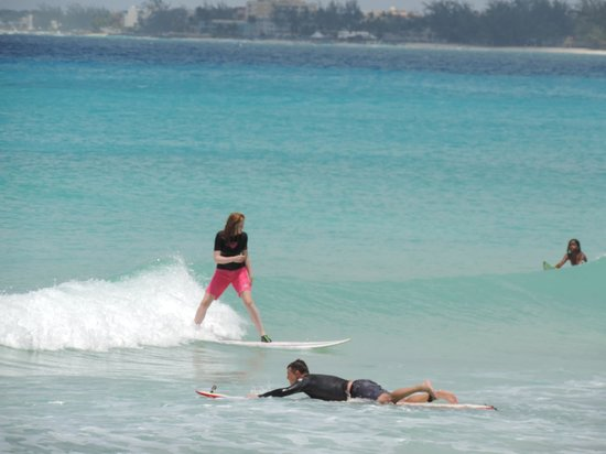 Zed's Surfing Adventures: my daughter catching a wave