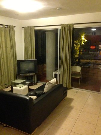International House Medellin: Shared living area and balcony