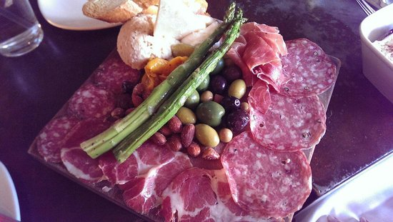Postino Winebar: Butcher block, assorted meats, cheeses, olives.