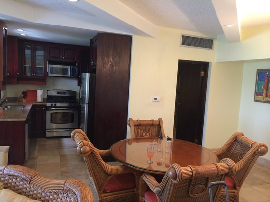Frangipani Beach Resort: Dining table and kitchen, 4A.
