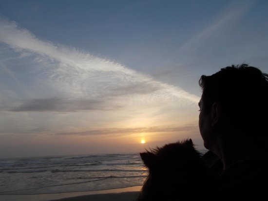 Surfside Resort : Me and my dog looking at sunset from balcony!