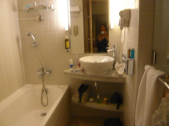 Novotel Suites Dubai Mall of the Emirates: bathroom has bath and shower...toilet in another room! Nice shelf for your stuff