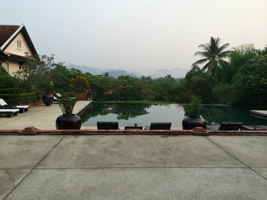Belmond La Résidence Phou Vao : View over pool, to hills beyond. Tranquility personified!
