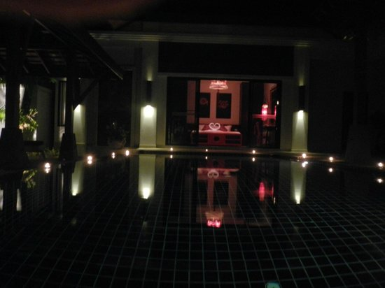 The Bell Pool Villa Resort Phuket : pool with candles all around it
