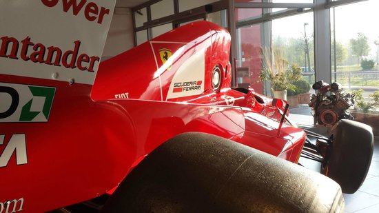 Hotel Maranello Village : Replica car at the reception