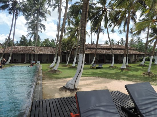 Apa Villa Thalpe: View of the back side, verandas and pool, from the beach.