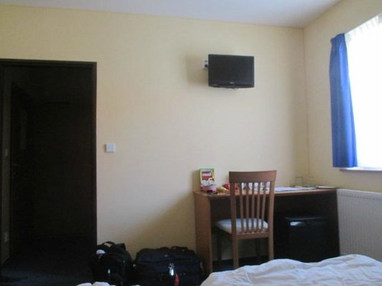 Adeba Hotel: Tiny TV high on wall