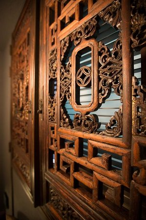 Hotel Mume: Gorgeous woodworking on the Chinese window door.