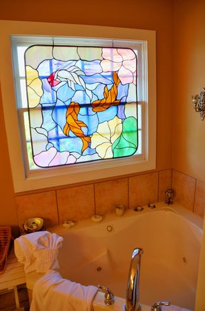 Equinox Inn at Biscuit Hill : Captain's Bay whirlpool stained glass window.