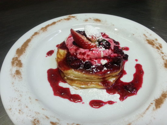 Fresh: Fluffy Buttermilk pancakes topped with a mixed berry compote and creamy Greek yogurt