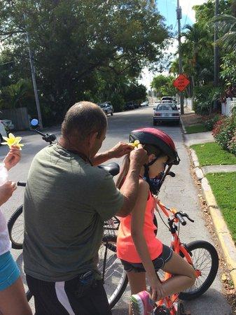 Lloyd's Tropical Bike Tour: Lloyd puts a flower in my daughter's hair