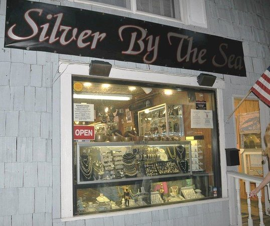 Silver by the Sea: Night shot outside store.