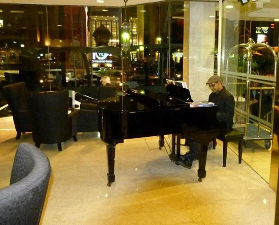 Melia Kuala Lumpur: The Pianist at night :)