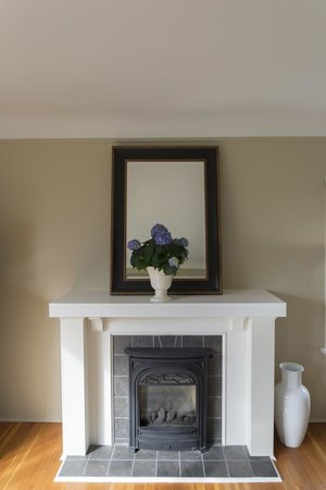 Fairholme Manor: Working fireplace--fresh flowers were everywhere in the suite