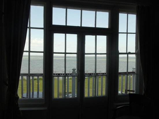 The Marine Hotel: The ill fitting and poorly secured secondary glazed french doors in room 11.