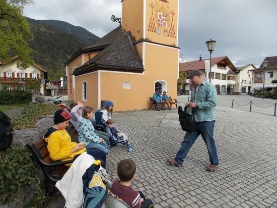 All Things Garmisch - Day Tours: Jake teaches the kids the history of this little chapel in Partenkirchen.