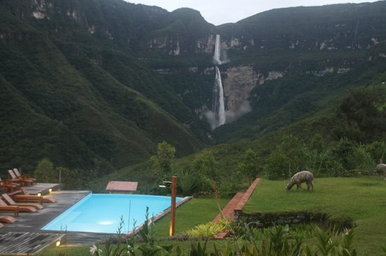 Gocta Andes Lodge: A Room with a view of a waterfall and a llama