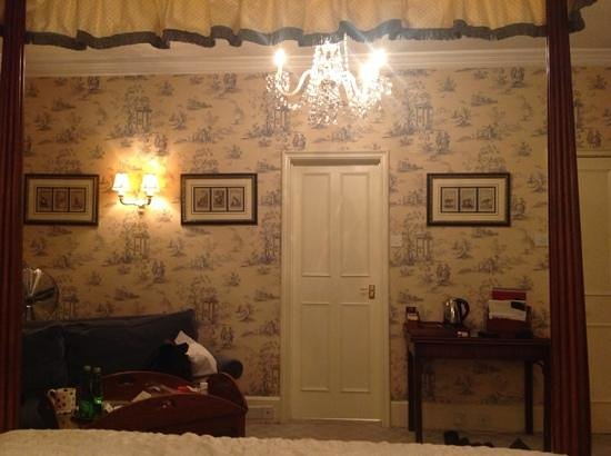 The Bath Priory: view from four poster bed to the bathoom door