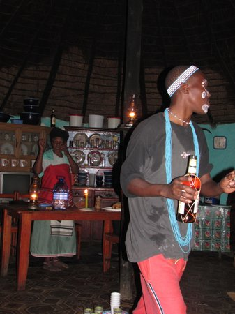 East London, แอฟริกาใต้: An Xhosa tradition of drinking Xhosa maize beer (Umqombothi) and a shot (Dop as the Xhosa call i