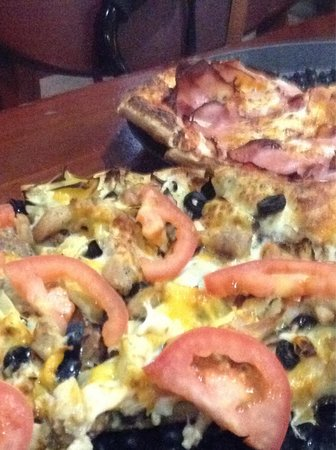 Mike's Pizza of Sonora: Front: pesto California!  Pack: Canadian bacon with cheese! Both so good! You just want to kee
