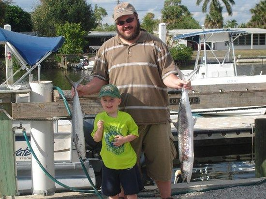 Saltwater Cowboy Charters: My son and I after his 1st trip with a few of our King mackerals