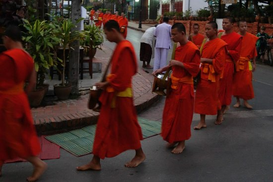 Alms Giving Ceremony: Older monks passing by