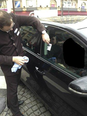 Hotel du Louvre: Hotel staff cleaning damage to our car, after a extended wait for it to be returned.