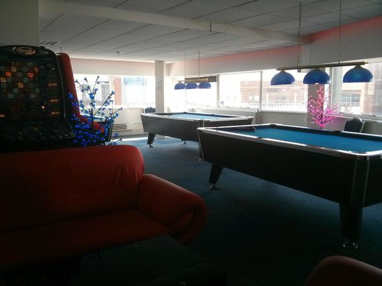 Astro City: Large comfy sofas and pool tables