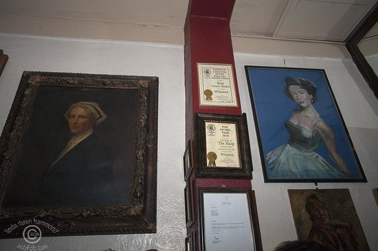 The Harp: Best Pub Awards and paintings on wall