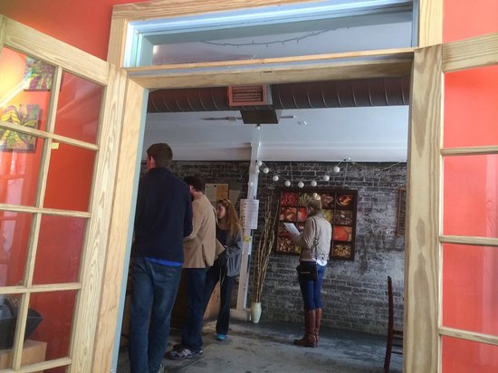 Carmo : Looking through the doorway to the menus/ register and part of the cafe where you walk in.