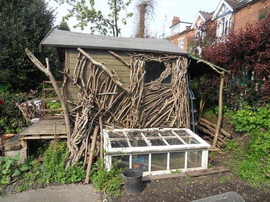 Hill Close Gardens: A wooden built summer house