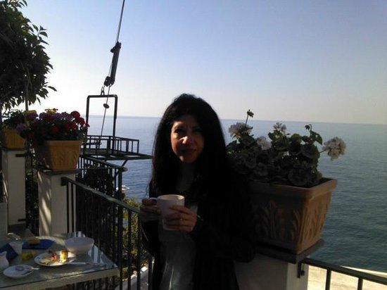 Hotel Villa Maria Pia: My wife having coffee on the hotel terrace.